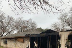 Home exterior fire damage to siding.