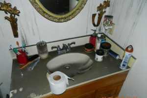 Home interior bathroom with fire damage.