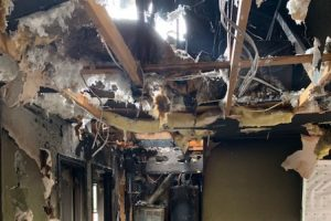 Fire damage in a home interior.