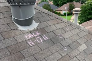 Residential roof with hail damage.