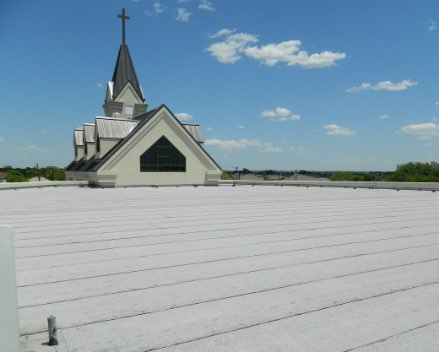 Church rooftop with hail damage.